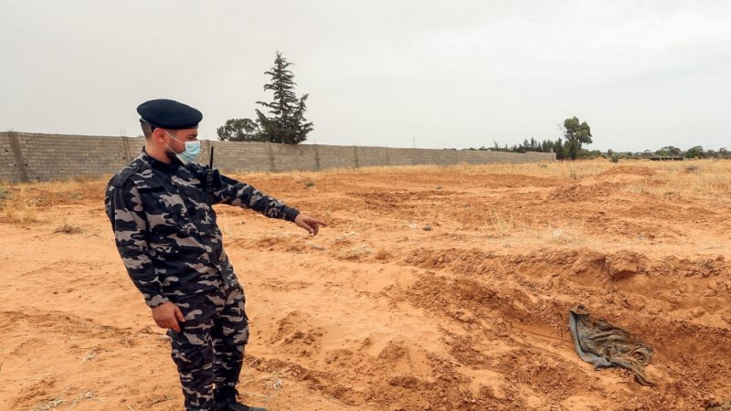 Twelve bodies found in Libya mass graves
